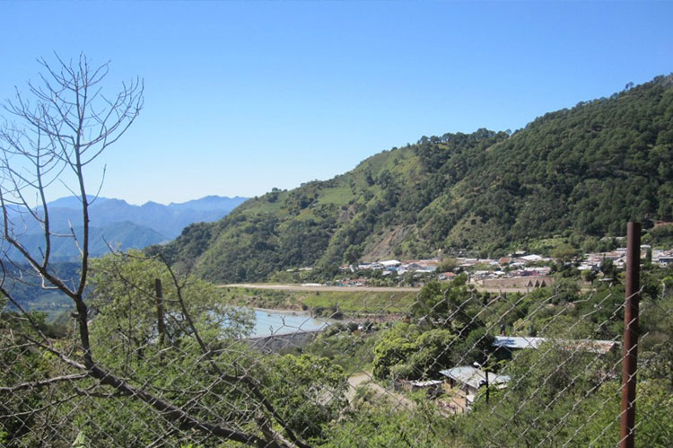 View from the road. Airstrip is visible below the town and above the reservoir.